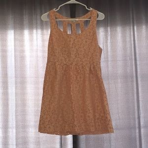 Nude lace dress with fun back!